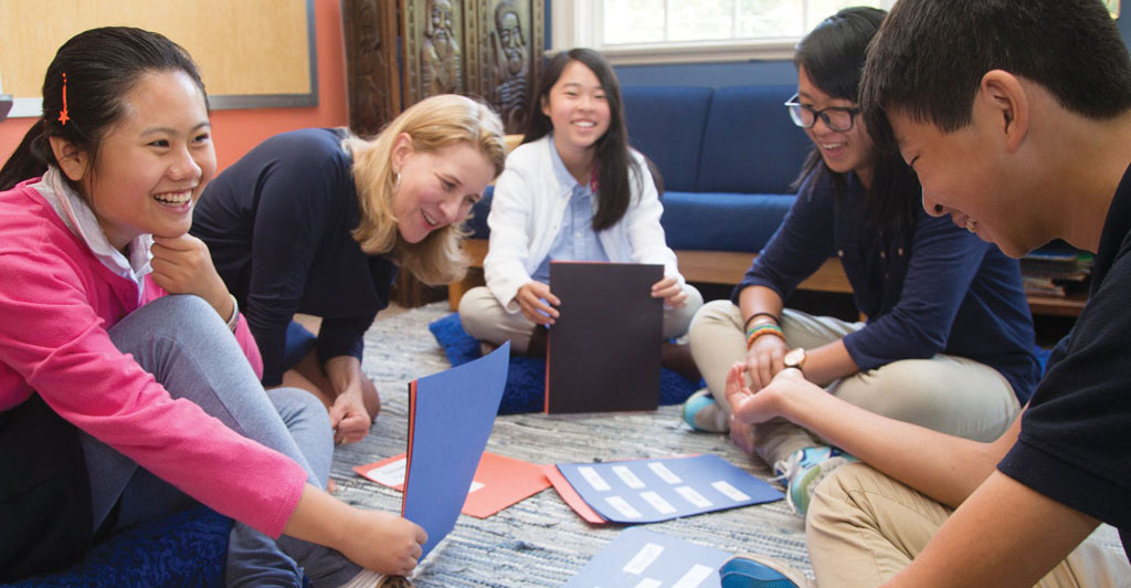 Fifth grade teacher Karen Gaul provides English language lessons for Middle School students from China