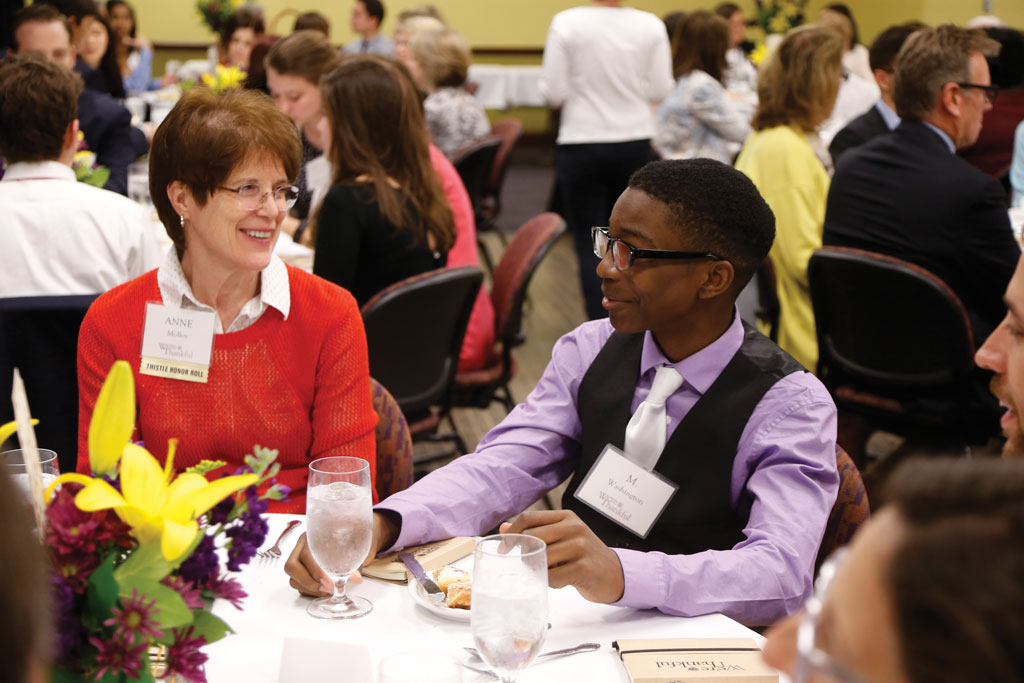 Anne Molloy, Alumnae/i Parent and member of the Thistle Honor Roll, and WT freshman M. Washington enjoy lunch.