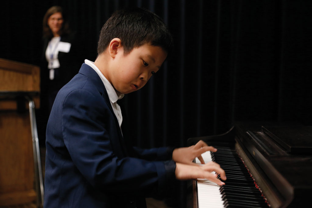 Fourth grader Christian Zhu entertains on the piano.