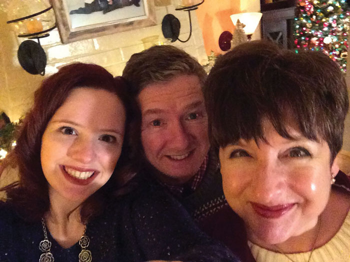 Peggy Jo Vanderbeck Thomas '79 (R) with her daughter Shellby (L) and husband Dan (C), at Christmas