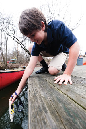 WT-Smart-pFifth grader Colin Helbling tests the water at the North Hills Campus pond.ond3