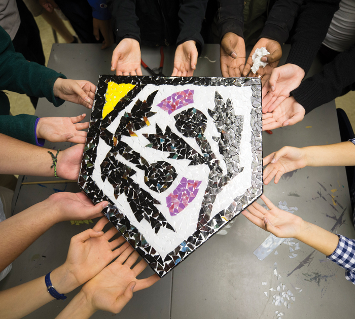 Students holding a mosaic