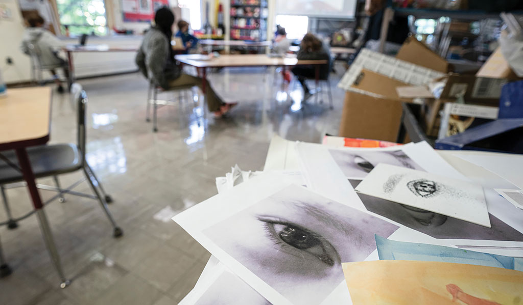 Piles of art in a classroom