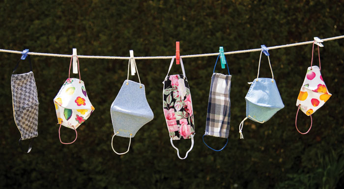 face masks on a clothes line